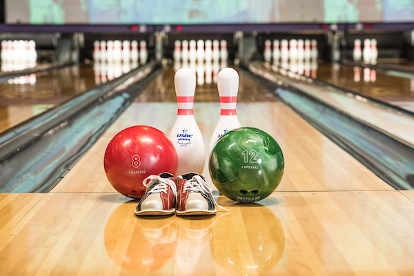 Bowling balls, pins and shoes